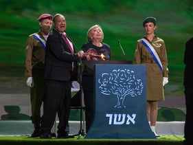 Actors Ze'ev Revach and Leah Koenig light a beacon during Israel 70 Independence Day celebrations