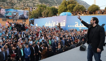 Lebanon's Prime Minister Saad al Hariri waves during an election campaign in the northern town of Deniyeh, Lebanon, April 28, 2018.
