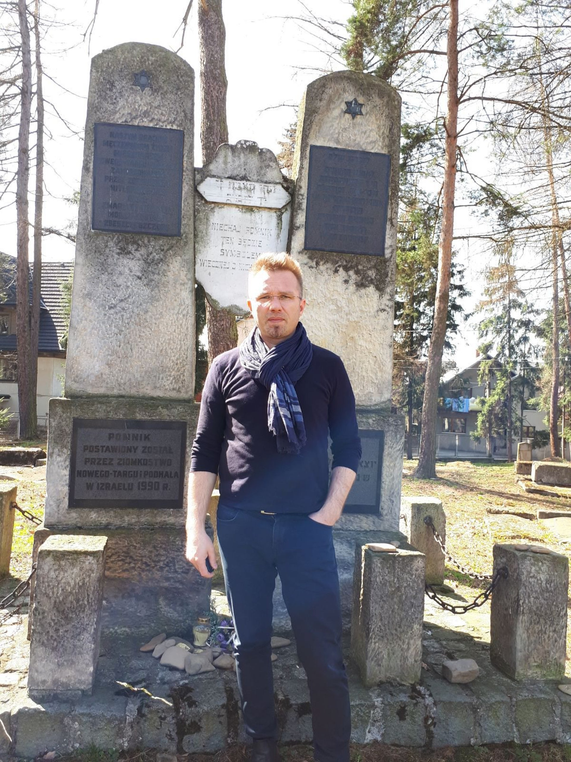 Tadeusz Krolczyk standing in the Jewish cemetery at Nowy Targ.