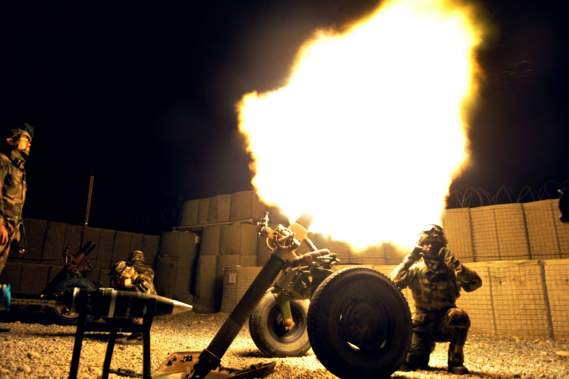 French soldiers of the first regiment of marine artillery fire a mortar at their base during an exercise in Surobi district of Kabul province, March 12, 2012.