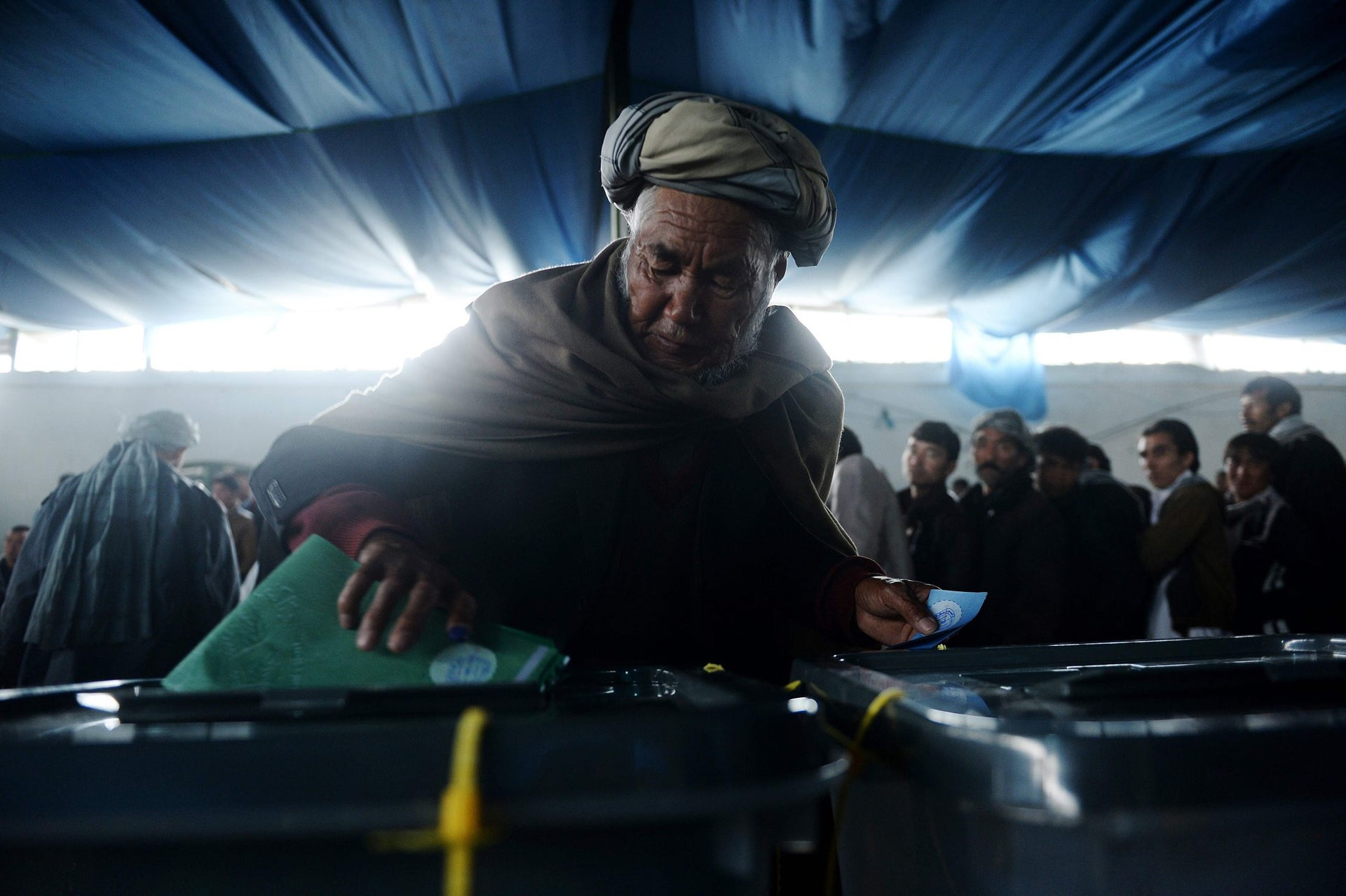 An Afghan man casts his vote at a local polling station in Kabul, April 5, 2014.