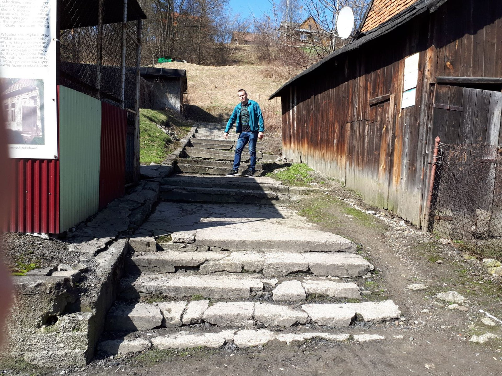 Narcyz Listowski on the steps leading to the destroyed synagogue at Rabka.