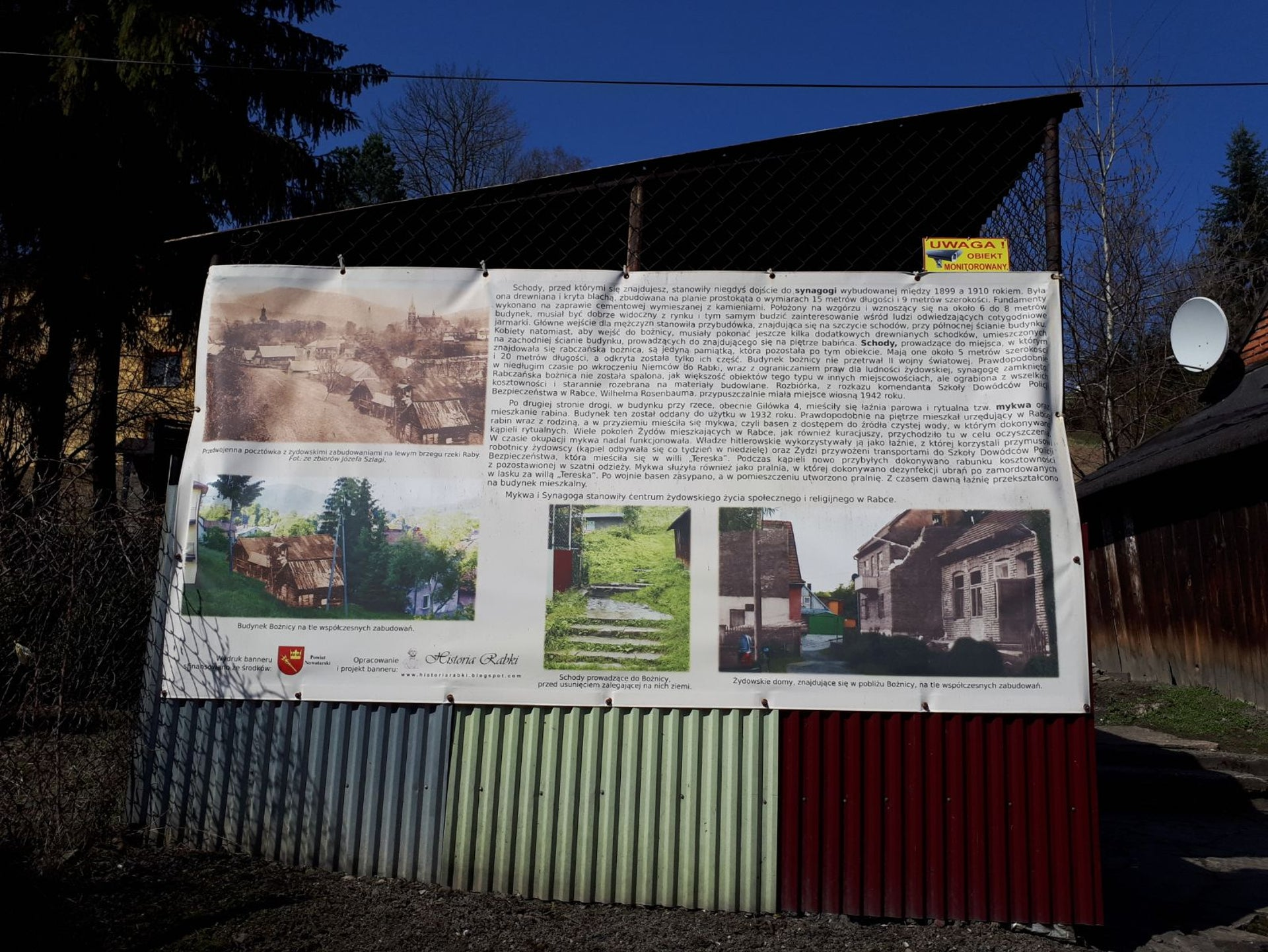 Narcyz Listowski's sign near the old synagogue steps, explaining the significance of the site in the town of Rabka.