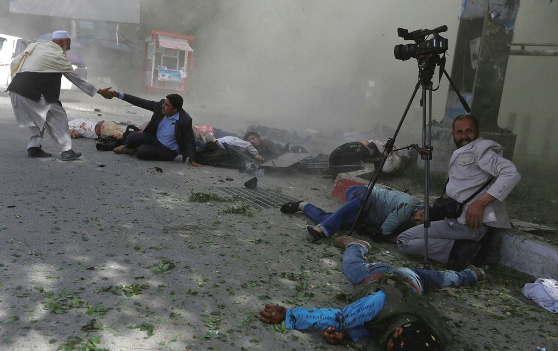 Afghan journalists are seen after a second blast in Kabul, Afghanistan, April 30, 2018