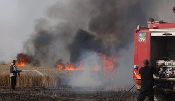 The fire that destroyed 350 dunams of land near Kibbutz Be'eri, caused by a Molotov cocktail attached to a kite flown from Gaza on May 2, 2018.