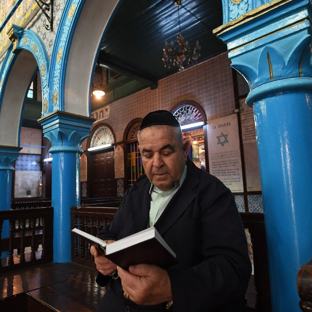 Pires Trabelsi, the president of the Ghriba synagogue, reads the Torah on May 1, 2018 in the Tunisian resort island of Djerba, one day before of the annual Jewish pilgrimage to the synagogue.