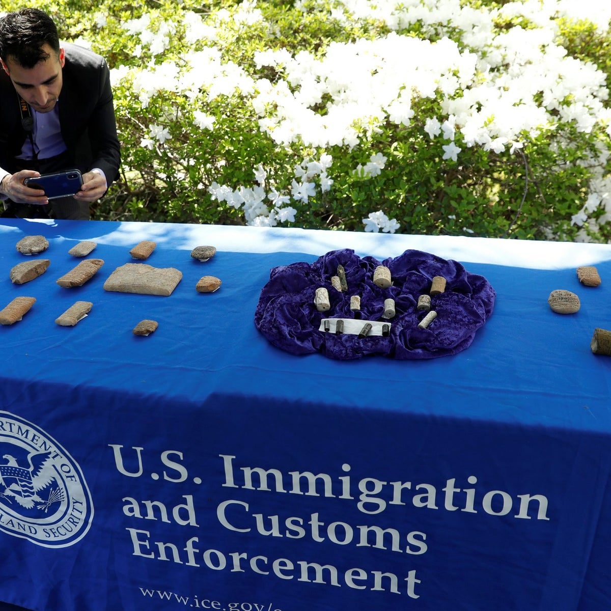 A man photographs artifacts on display, as U.S. Immigration and Customs Enforcement (ICE) hosts an event to return several thousand ancient artifacts to the Republic of Iraq, at the Iraqi ambassador's residence in Washington, DC, U.S., May 2, 2018.