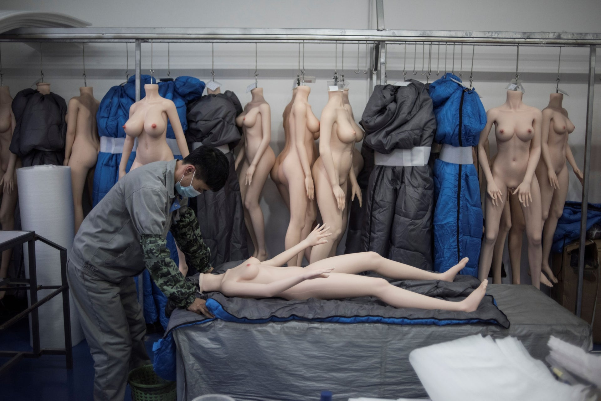 A worker preparing a silicone doll at a factory of EXDOLL, a firm based in the northeastern Chinese port city of Dalian.