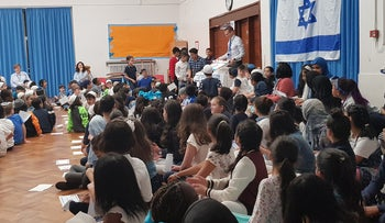 Students at King David Elementary School in Birmingham, England, celebrate Israel's 70th anniversary, April 19, 2018