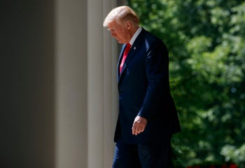 """President Donald Trump arrives for a """"National Day of Prayer"""" event at the White House, May 3, 2018."""