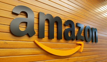 FILE PHOTO: The logo of Amazon is pictured inside the company's office in Bengaluru, India, April 20, 2018.
