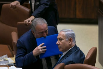 Netanyahu and Lieberman at the Knesset.