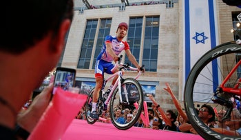 Groupama FDJ cyclist France's Thibaut Pinot rides during the team's presentation in Jerusalem, Thursday, May 3, 2018. The Giro d'Italia, Tour of Italy cycling race is scheduled to start on Friday in Jerusalem. (AP Photo/Ariel Schalit)