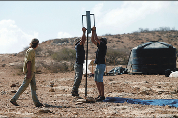 Israeli settlers start to build a new illegal outpost north of the West Bank Palestinian village of Ain al-Baida on October 25, 2016.   מאחז בלתי חוקי חדש  צפון בקעת הירדן התנחלות מתנחלים הקמה של מאחז קונפליקט יהודים פלסטינים  More than 400,000 Israelis live in settlements in the occupied West Bank, considered by the international community one of the largest obstacles to peace.
