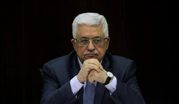 FILE PHOTO -  Palestinian President Mahmoud Abbas heads a Palestinian cabinet meeting in the West Bank city of Ramallah July 28, 2013. REUTERS/Issam Rimawi/Pool/File Photo
