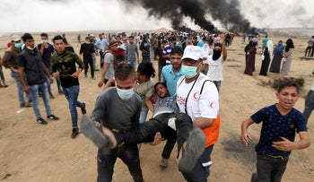 A wounded demonstrator is evacuated during clashes with Israeli forces on the Israel-Gaza border, May 4, 2018.