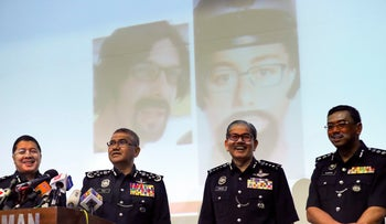 Malaysian National police chief Mohamad Fuzi Harun, second left, speaks during a press conference in Kuala Lumpur, Malaysia, April 25, 2018.