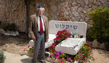 Dr. Yosef Shiklosh in front of his wife's grave.