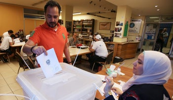 A man casts his vote at a polling station during the parliamentary election, in Sidon, Lebanon May 6, 2018.