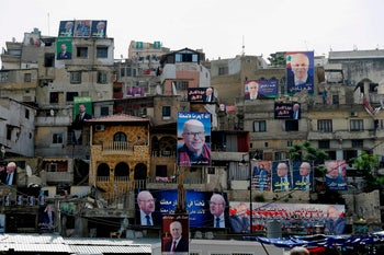Posters of candidates for the upcoming Lebanese parliamentary elections hang on the walls of buildings in northern Lebanese city Tripoli's adjacent Bab al-Tabbaneh and Jabal Mohsen neighbourhoods on May 3, 2018.