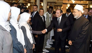 Egyptian President Abdel Fattah al-Sissi, center, is greeted at the Al-Azhar Mosque in Cairo, March 6, 2018.