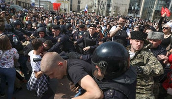 Russian police detain protesters at a demonstration against President Vladimir Putin in Pushkin Square as Russians angered by the impending inauguration of Vladimir Putin to a new term as the country's president demonstrated throughout the country on Saturday
