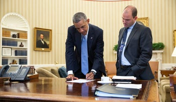 FILE PHOTO: U.S. President Barack Obama with senior media adviser Ben Rhodes in the White House, September 10, 2014.