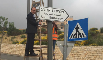 Jerusalem Mayor Nir Barkat poses with the new road signs leading to the U.S. Embassy in Jerusalem, May 7, 2018.