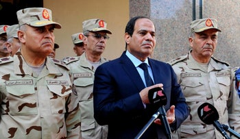 Egyptian President Abdel Fattah al-Sissi addresses journalists surrounded by top military generals in 2015