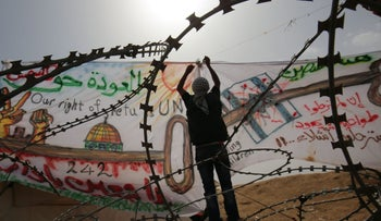 Palestinians take part in a protest demanding the right of return to what is now Israel, at the Israel-Gaza border, east of Khan Yunis in the southern Gaza Strip. May 4, 2018
