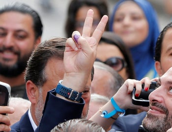 Lebanese prime minister and candidate for the parliamentary election Saad al-Hariri gestures after he casts his vote in Beirut, Lebanon, May 6, 2018. REUTERS/Jamal Saidi