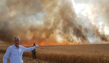 A fire in the fields of Kibbutz Nir Am near the Gaza border on Monday, May 7.