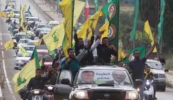 Supporters of Lebanon's Hezbollah and Amal Movement gesture as they ride in a car in Marjayoun, Lebanon May 7, 2018. REUTERS/Aziz Taher