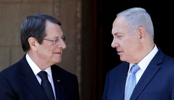 Cypriot President Nicos Anastasiades and Israeli Prime Minister Benjamin Netanyahu talk outside the Presidential Palace in Nicosia, Cyprus May 8, 2018. REUTERS/Yiannis Kourtoglou