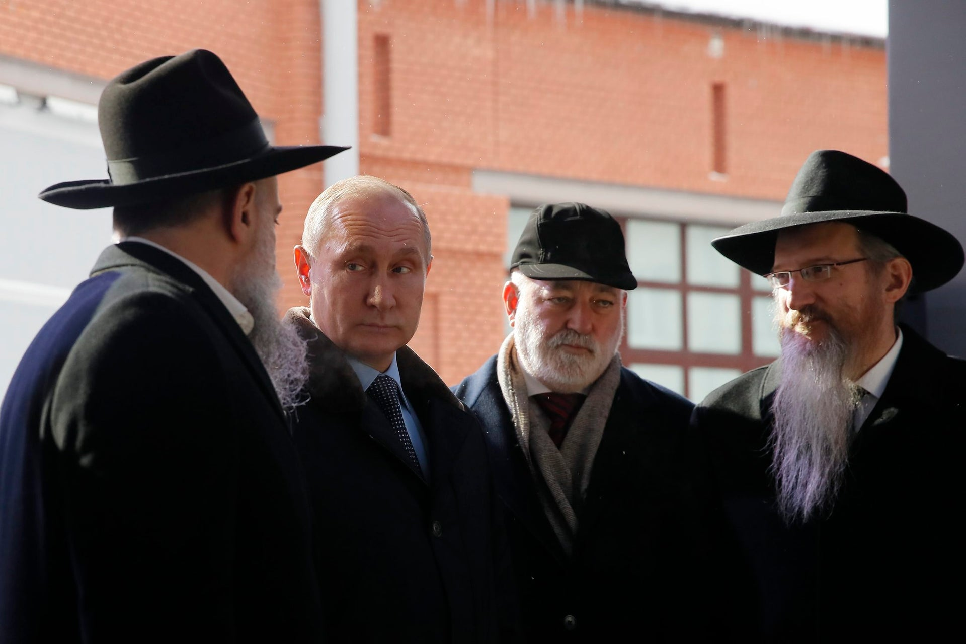 Russian President Vladimir Putin with Chief Rabbi of Russia Berel Lazar, right, at the Jewish Museum and Tolerance Center in Moscow, January 29, 2018.