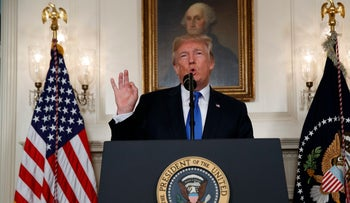 President Donald Trump delivers a statement on the Iran nuclear deal from the Diplomatic Reception Room of the White House, Tuesday, May 8, 2018, in Washington