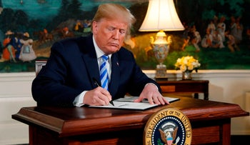 U.S. President Donald Trump signs a proclamation declaring his intention to withdraw from the Iran nuclear deal, May 8, 2018.