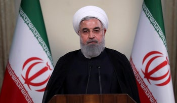 In this photo released by official website of the office of the Iranian Presidency, President Hassan Rohani addresses the nation in a televised speech in Tehran, Iran, Tuesday, May 8, 2018.