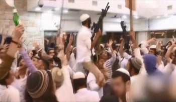 Screenshot from video of wedding in 2015 in which radical settlers appeared to celebrate a fatal firebombing in the Palestinian village of Duma.