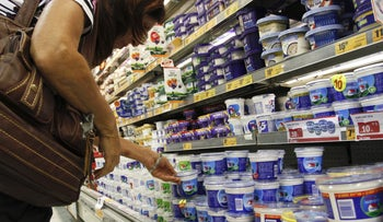 File photo: A shopper browses the dairy aisle at a supermarket in Israel.