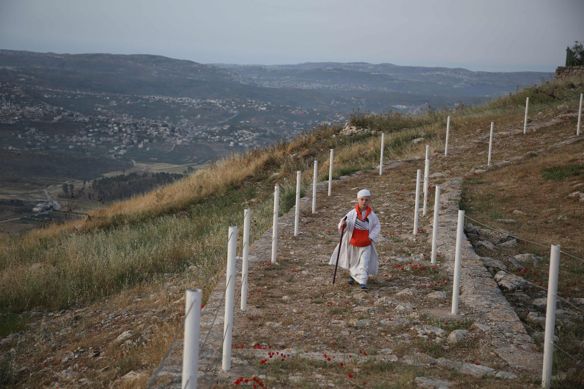 A young Samaritan worshipper walking up Mount Gerizim, near Nablus, to participate in an early morning Passover ceremony on May 6, 2018.