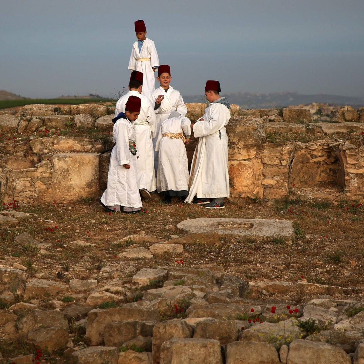 Young Samaritan worshippers resting during a Passover ceremony at Mount Gerizim, May 6, 2018.