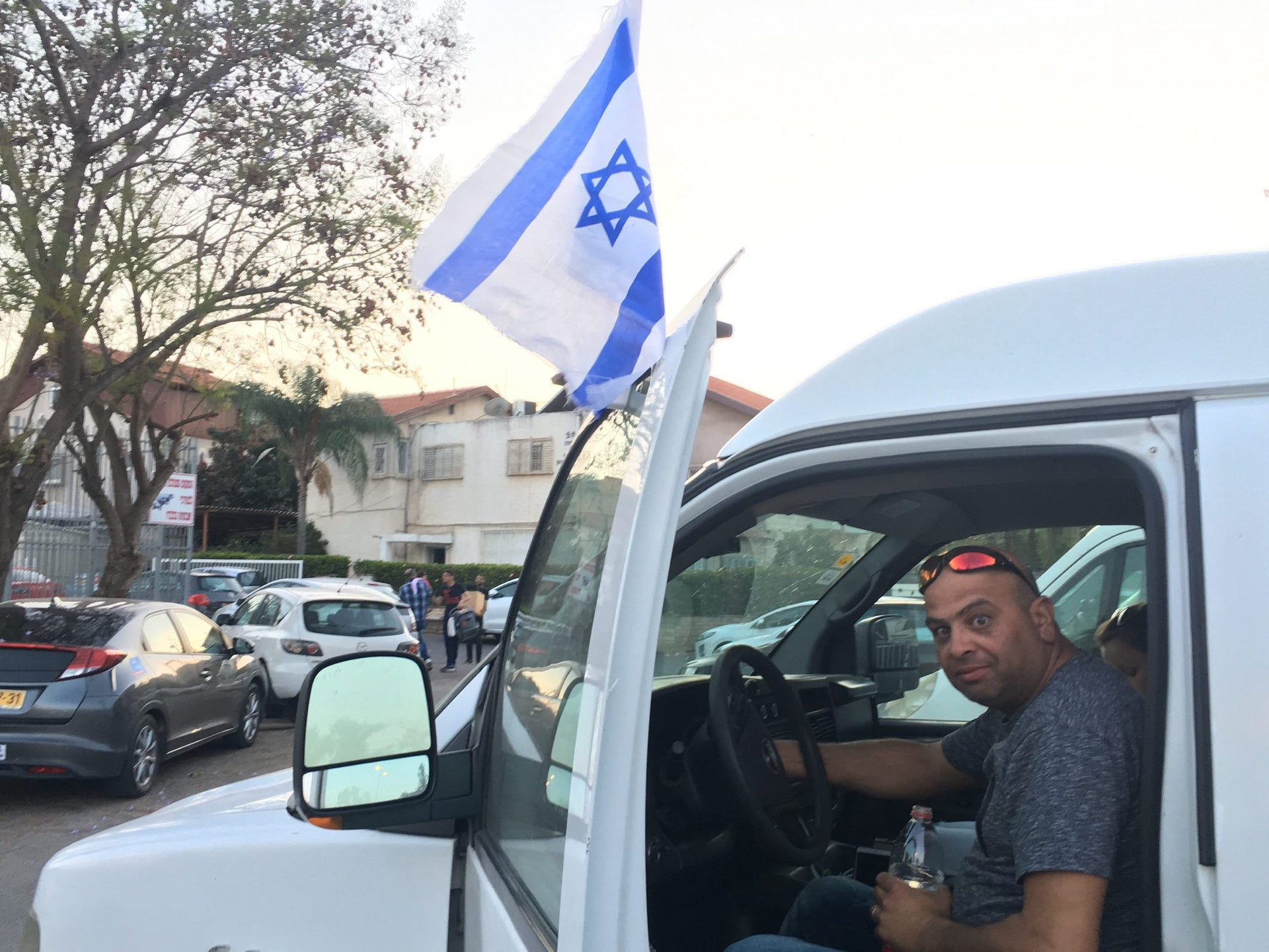 FLAGBEARER: Jacov getting ready to leave Holon for the other Samaritan community – in Kiryat Luza, near Nablus, in the West Bank.