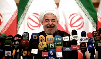Iranian President Hassan Rohani speaks during a press conference in Tehran on June 17, 2013.
