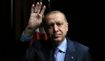 Turkey's President Recep Tayyip Erdogan waves to supporters during an event in Ankara, Turkey. May 8, 2018