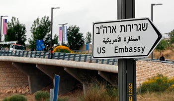 Road signs directing to the U.S. embassy are seen on a truck in Jerusalem on May 7, 2018.
