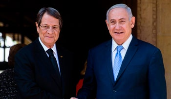 President of Cyprus Nicos Anastasiades welcomes Israeli Prime Minister Benjamin Netanyahu at the Presidential Palace in Nicosia May 8, 2018