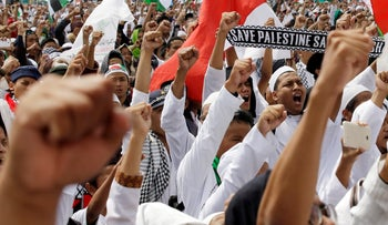 "Protesters shout slogans ""God is Great"" during a rally against the U.S. plan to move its embassy in Israel from Tel Aviv to Jerusalem, at Monas, the national monument, in Jakarta, Indonesia, Friday, May 11, 2018."