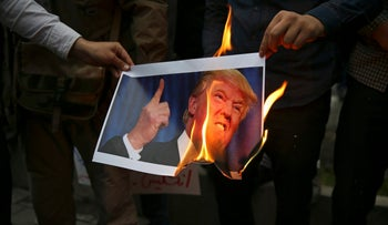 Iranians burn a picture of Donald Trump outside the former U.S. Embassy in Tehran after Washington's pullout from the nuclear deal, May 9, 2018.