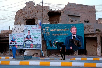 Campaign posters for parliamentary elections are displayed near destroyed buildings from fighting between Iraqi forces and the Islamic State in Ramadi, 115 kilometers west of Baghdad, Iraq on May 11, 2018.